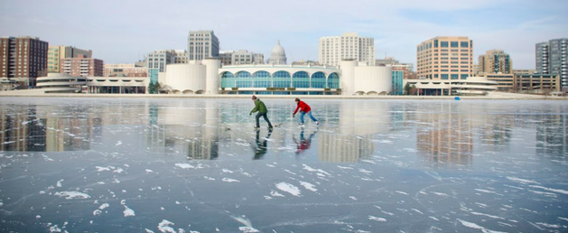 Residents of Madison, Wisconsin, play ice hockey on the frozen Lake Monona.